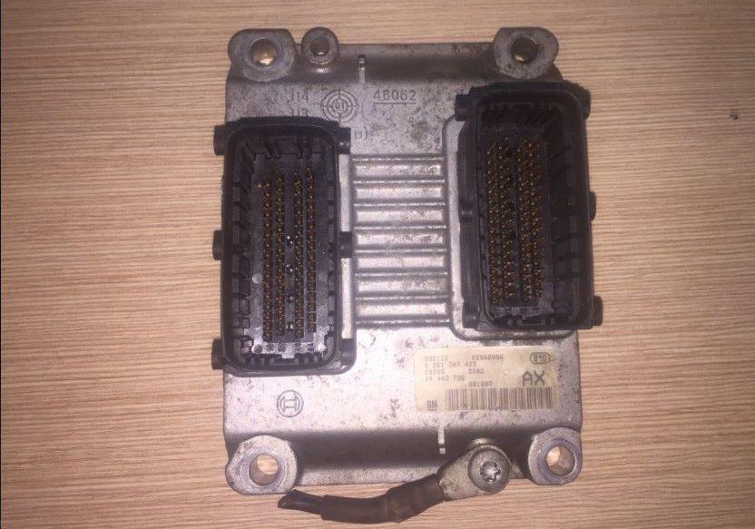 Блок управления двигателем OPEL CORSA 0261207423 24443796 AX